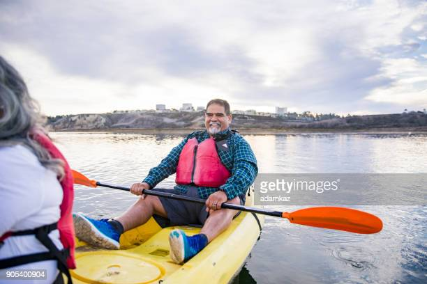 senior mexican couple kayaking - chubby men stock photos and pictures