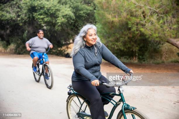 Senior Mexican Couple Riding Bikes