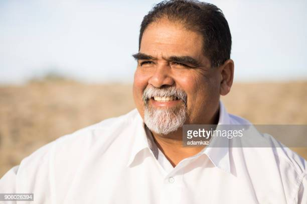 senior mexican man at the beach - fat guy on beach stock pictures, royalty-free photos & images