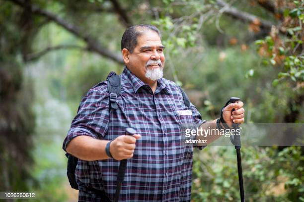 senior mexican man hiking - chubby men stock photos and pictures