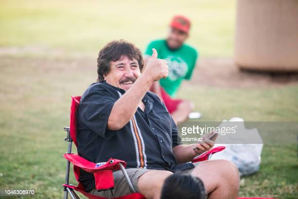 senior mexican man portrait at a soccer game - old american football stock photos and pictures