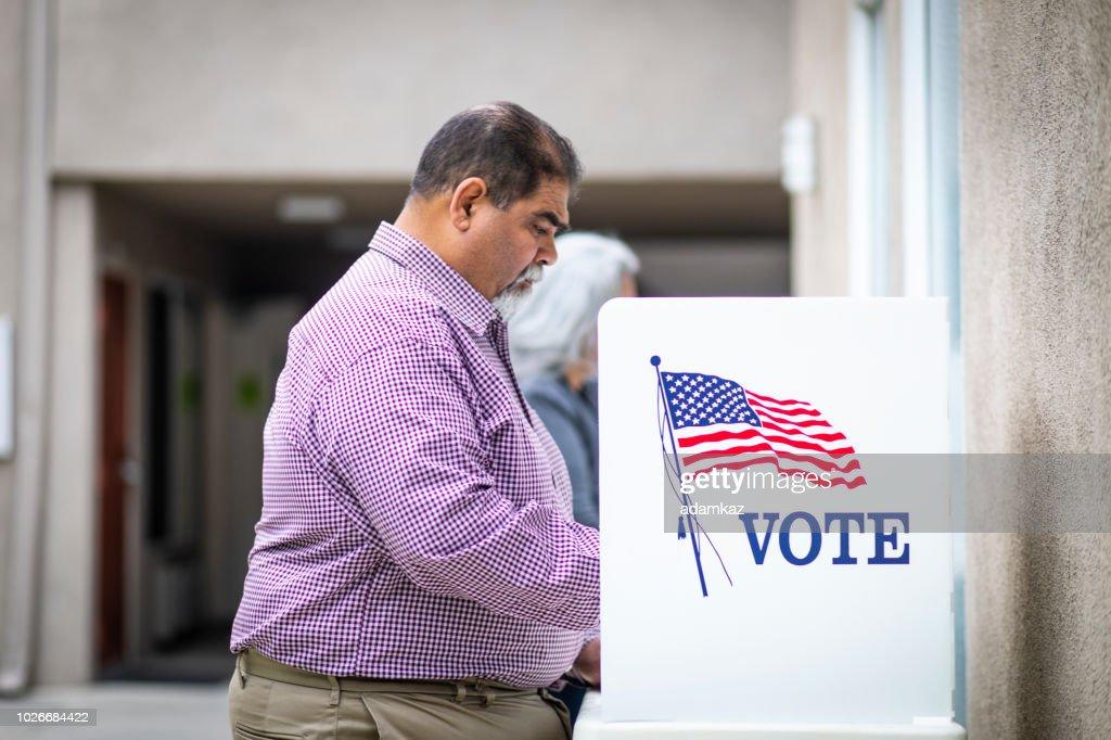 Senior Mexican Man Voting : Stock Photo
