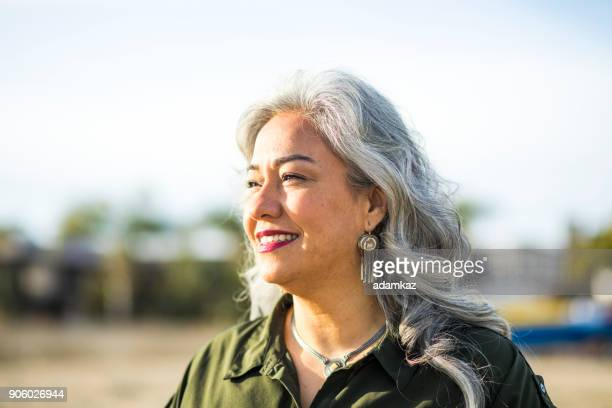 senior mexican woman at the beach - fat old lady stock photos and pictures