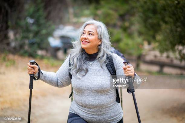 senior mexican woman hiking - fat old lady stock photos and pictures