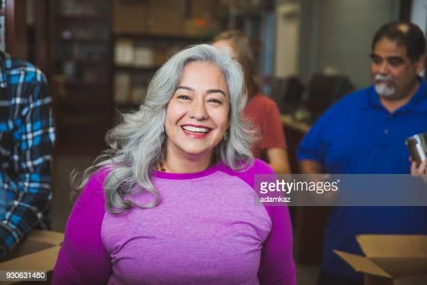 Senior Mexican Woman Volunteering at Food Bank