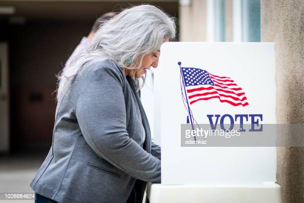 senior mexican woman voting - american influenced stock photos and pictures