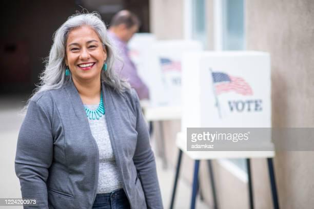 senior mexican woman voting - adamkaz stock pictures, royalty-free photos & images