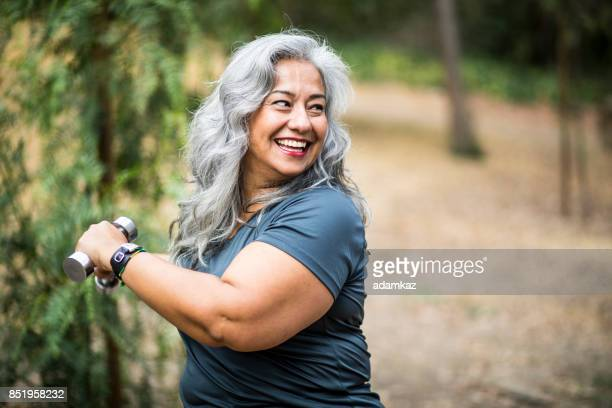 senior mexican woman working out - chubby stock photos and pictures