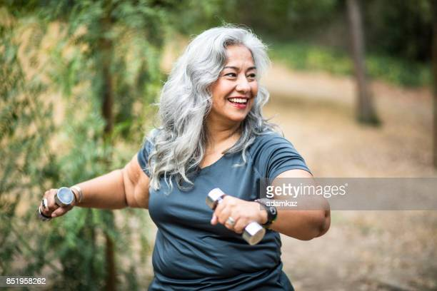 senior mexican woman working out - large build stock photos and pictures