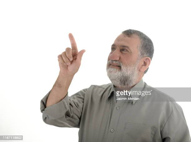 senior middle eastern man with pressing finger up - jordanian workforce stock pictures, royalty-free photos & images