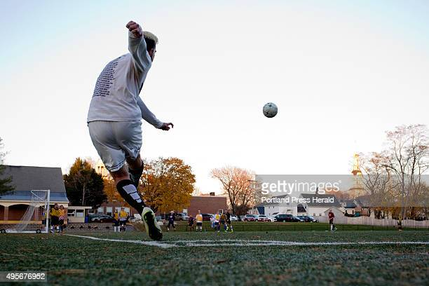 Senior midfielder Alex Nason of the Cheverus boys soccer team practices a corner kick at North Yarmouth Academy Tuesday November 3 in preparation for...