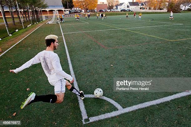 Senior midfielder Alex Nason of the Cheverus boys soccer team practices a corner kick at North Yarmouth Academy Tuesday November 3 in preparation for...
