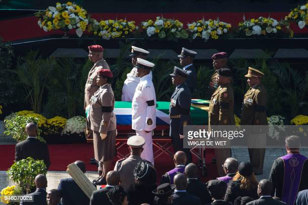 Senior military officials stand by after carrying the coffin of Winnie Madikizela-Mandela into Orlando Stadium in Soweto for a funeral ceremony, as...