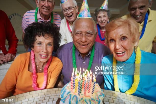 Senior Mixed Race man celebrating birthday