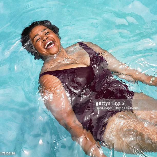 senior mixed race woman in swimming pool - images of fat black women stock photos and pictures