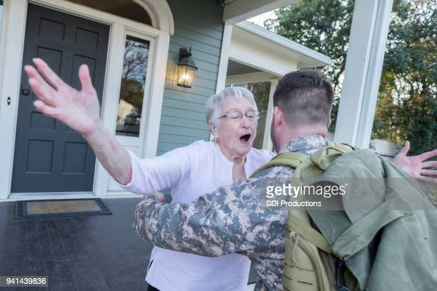 Senior mom runs to greet military son