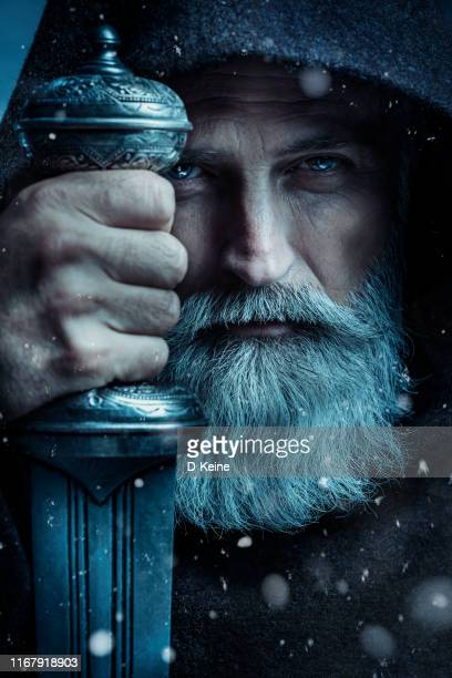 senior monk wearing traditional clothes with sword - wizard stock pictures, royalty-free photos & images
