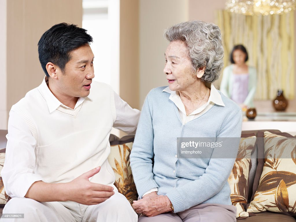 senior mother and adult son : Stock Photo