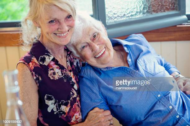 """senior mother and daughter having tender moment in summer house. - """"martine doucet"""" or martinedoucet stock pictures, royalty-free photos & images"""