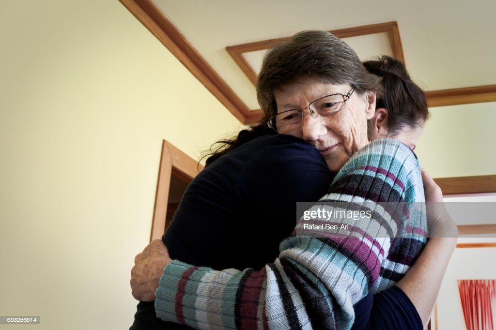 Senior mother and daughter hugging : Stock Photo