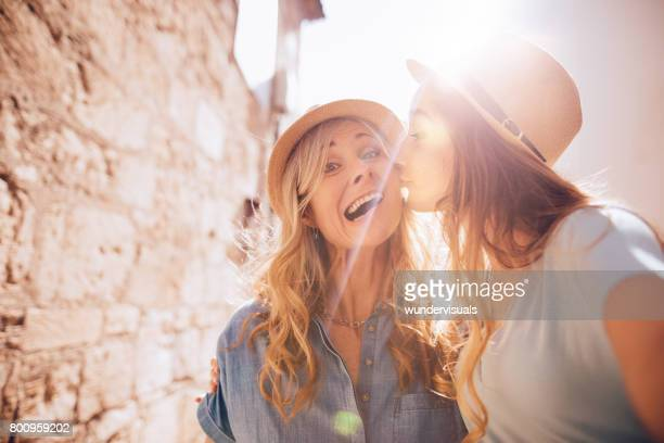 Senior mother and daughter on European vacations taking funny selfies