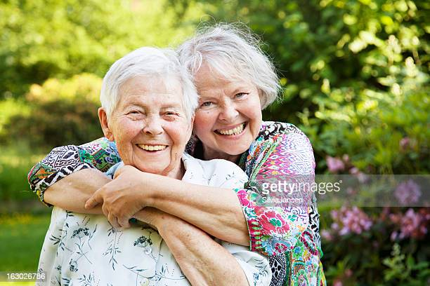 senior mother and mature daughter togetherness