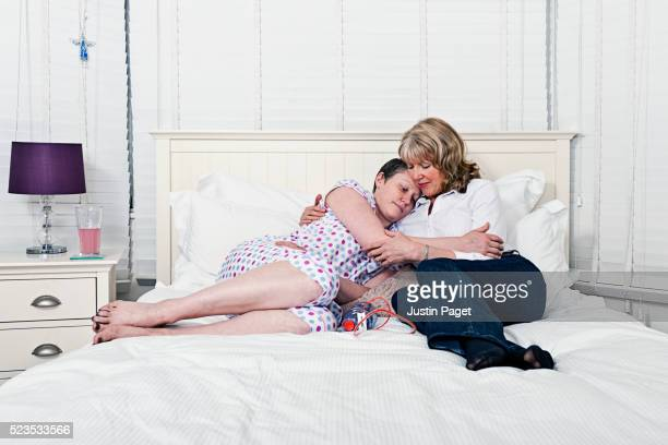 Senior Mother Comforting Daughter