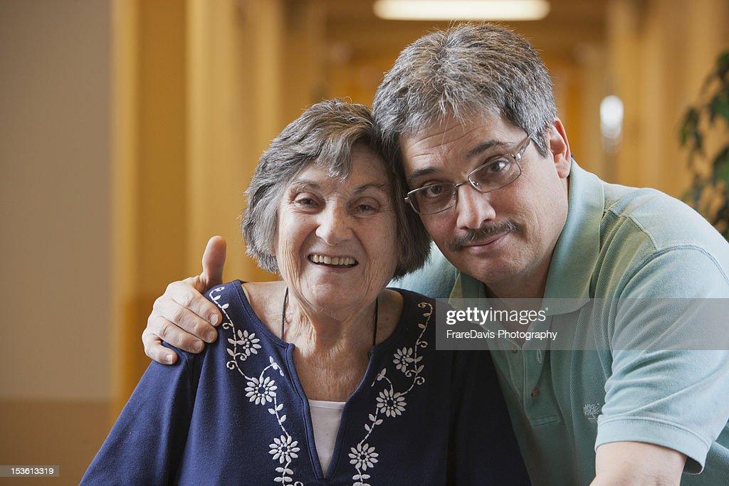 Senior mother happy with adult son : Photo