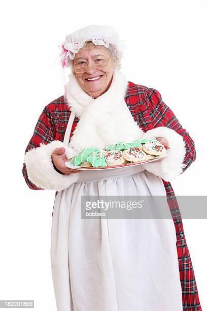 senior signora natale con biscotti - mamma natale foto e immagini stock