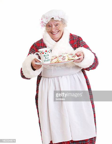 Senior Mrs Claus with milk and cookies