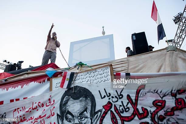 Senior Muslim Brotherhood member, Mohammed al-Beltagy, speaks to supporters of deposed Egyptian President Mohammed Morsi at a sit-in demonstration...