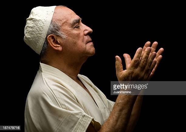 senior muslim man praying - arab old man stock pictures, royalty-free photos & images
