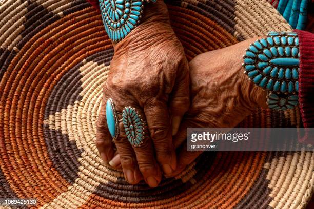 senior native american navajo woman wearing traditional turquiose jewelry - indigenous culture stock pictures, royalty-free photos & images