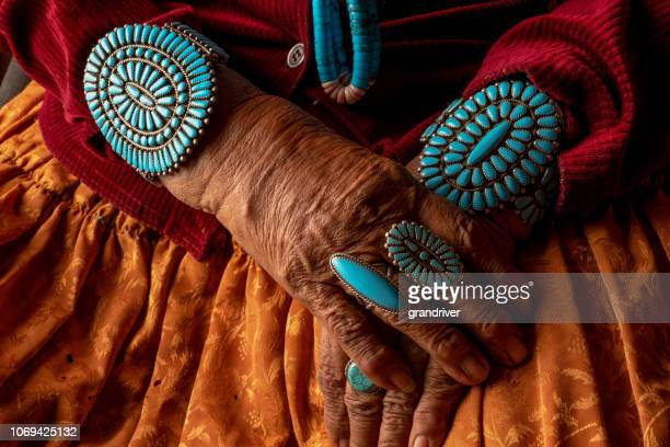 senior native american navajo woman wearing traditional turquiose jewelry - navajo hogan stock photos and pictures