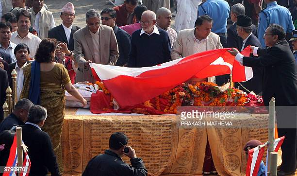 Senior Nepali Congress party leaders lay the party flag over the body of former prime minister and party leader Girija Prasad Koirala in Kathmandu on...