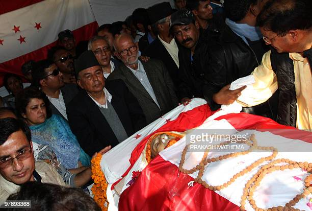 Senior Nepali Congress party leaders stand by the body of former prime minister and party president Girija Prasad Koirala in Kathmandu on March 20...
