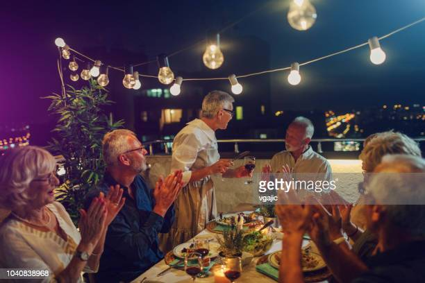 senior new year rooftop party - 70 year old man stock pictures, royalty-free photos & images