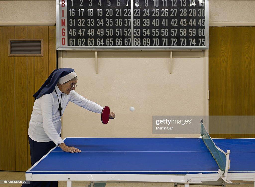 Senior nun playing table tennis : Stock Photo