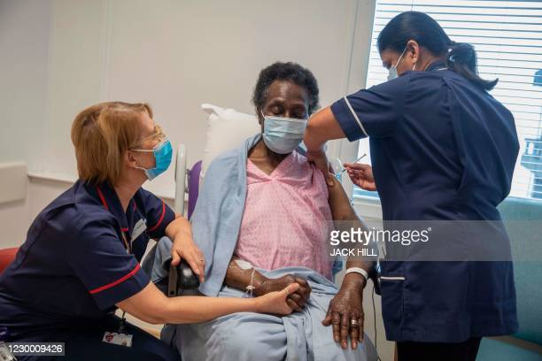 Senior nurse Dilhani Somaweera administers the Pfizer-BioNTech Covid-19 vaccine to Josephine Faleye at the Royal Free hospital in London on December...