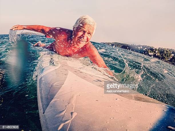 Senior on a surfboard