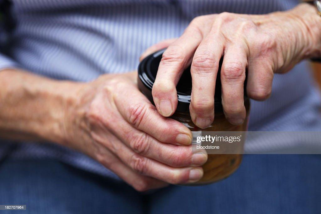 Senior opening jar : Stock Photo