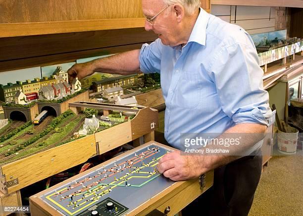 Senior operates model railway