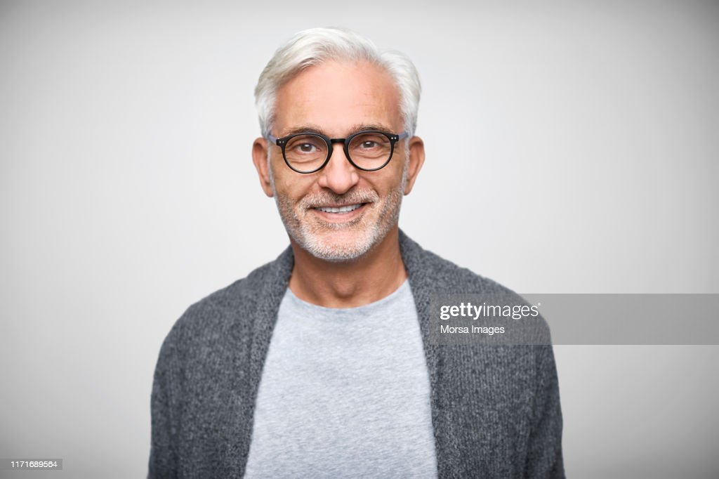 Senior owner wearing eyeglasses and smart casuals : Foto de stock