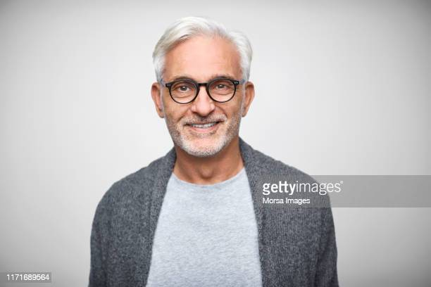 senior owner wearing eyeglasses and smart casuals - porträt stock-fotos und bilder