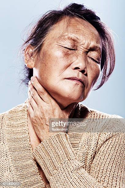senior pain in a throat - throat photos stock photos and pictures