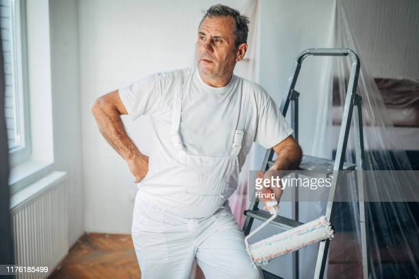 senior painter - man wrapped in plastic stock pictures, royalty-free photos & images