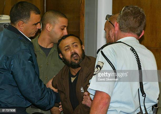 Senior Palestinian activist Marwan Barghouti is dragged by Israeli police out of court as he exchanges verbal insults with bereaved Israelis January...