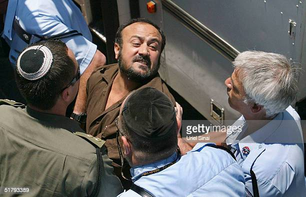 Senior Palestinian activist Marwan Barghouti is pushed by Israeli police into court June 6 2004 in Tel Aviv Israel Two weeks after Yasser Arafat was...