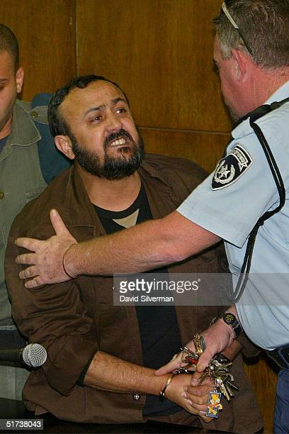 Senior Palestinian activist Marwan Barghouti is restrained by an Israeli policeman as he exchanges verbal insults with bereaved Israelis January 2...