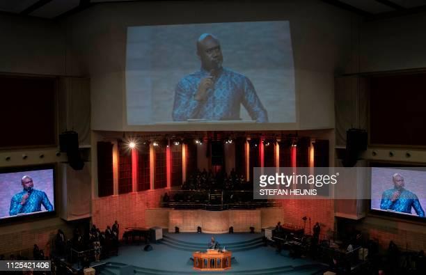Senior Pastor Paul Adefarasin leads a Sunday service at the House On The Rock Church in Lagos on February 17 2019 as religious leaders across Nigeria...